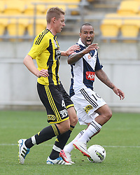 Archie Thompson of the Victory calls to the ref as he is tackled by Brent Griffiths of the Phoenix in the A-League football match at Westpac Stadium, Wellington, New Zealand, Sunday, October 30, 2011. Credit: SNPA / Marty Melville